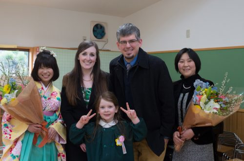 With some of Madeleine's teachers after her graduation from kindergarten